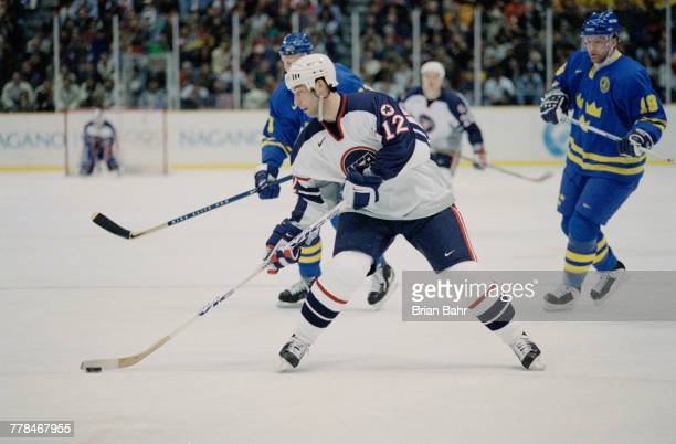 Bill Guerin of theUnited States controls the puck during the Group D game against Sweden in the Men's Ice Hockey tournament on 13 February 1998...