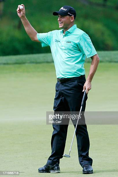Bill Haas celebrates after putting out on the 18th green to win the ATT National at Congressional Country Club on June 30 2013 in Bethesda Maryland