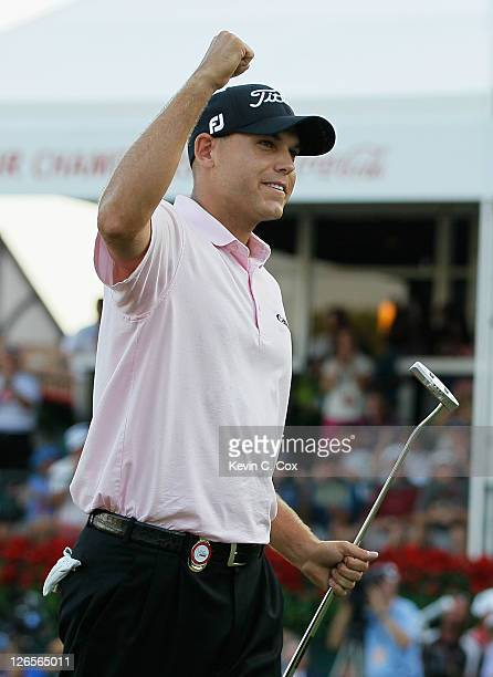 Bill Haas celebrates on the 18th green after defeating Hunter Mahan on the third playoff hole to win both the the TOUR Championship and the FedExCup...