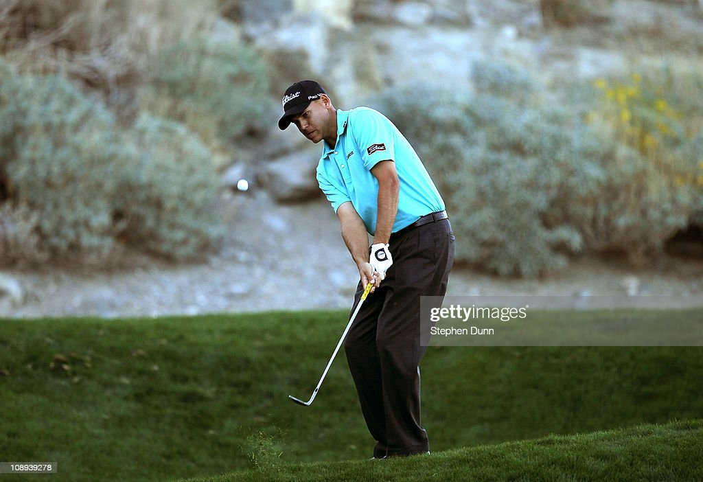 Bill Haas chips on the 14th hole during the final round of the Bob Hope Classic on the Palmer Private Course at PGA West on January 23, 2011 in La Quinta, California.