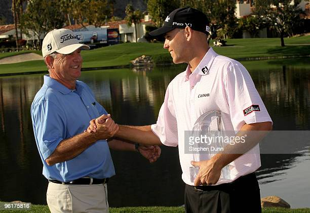 Bill Haas is congratulated by father and former tournament champion Jay Haas on the 18th green after Bill's victory at the Palmer Private course at...