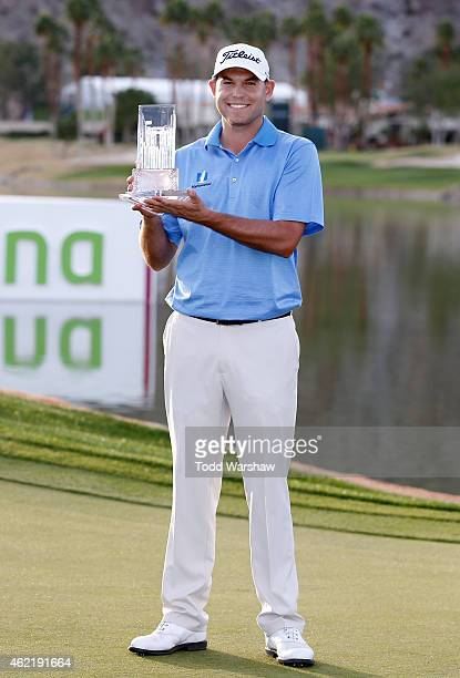 Bill Haas of the United States poses with the trophy after winning the final round of the Humana Challenge in partnership with The Clinton Foundation...