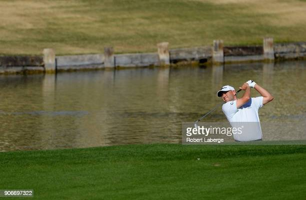 Bill Haas plays his shot on the ninth hole during the first round of the CareerBuilder Challenge at the TPC Stadium Course at PGA West on January 18...