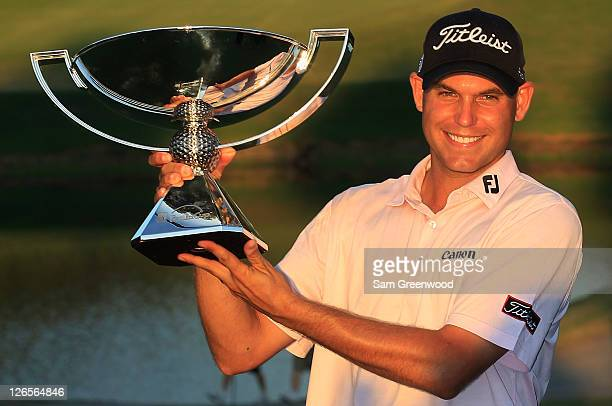 Bill Haas poses on the 18th green with the FedExCup after winning both the FedExCup and the TOUR Championship after the final round of the TOUR...
