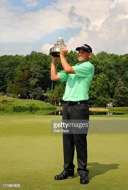 Bill Haas poses with the trophy after winning the ATT National at Congressional Country Club on June 30 2013 in Bethesda Maryland