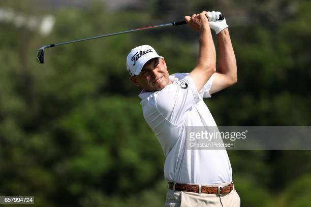 Bill Haas tees off on the 13th hole of his match during the semifinals of the World Golf ChampionshipsDell Technologies Match Play at the Austin...