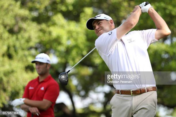 Bill Haas tees off on the 8th hole of his match against Jon Rahm of Spain during the semifinals of the World Golf ChampionshipsDell Technologies...