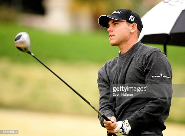 Bill Haas watches a tee shot during the fifth round of PGA Tour Qualifying Tournament at PGA West on December 5 2004 in La Quinta California