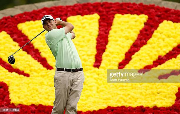 Bill Haas watches his tee shot on the 18th hole during the third round of the Shell Houston Open at the Redstone Golf Club on March 30 2013 in Humble...