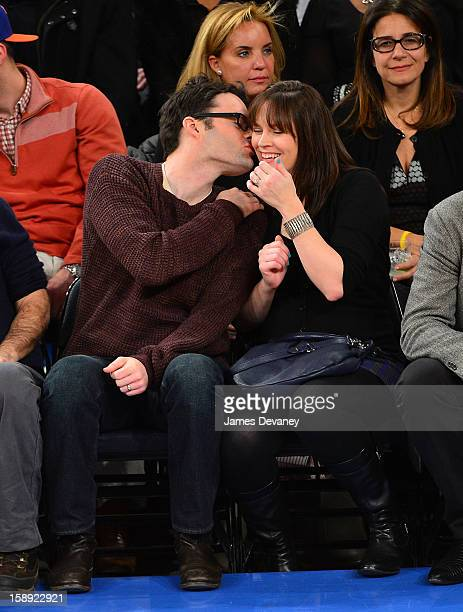 Bill Hader and Maggie Carey attend the San Antonio Spurs vs New York Knicks game at Madison Square Garden on January 3 2013 in New York City