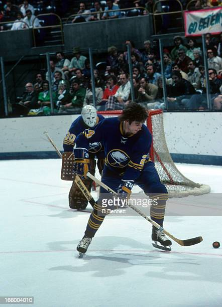 Bill Hajt of the Buffalo Sabres goes for the puck during an NHL game against the California Golden Seals circa 1976 at the Oakland Coliseum in...