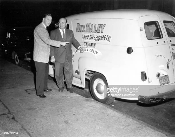 Bill Haley and Decca Records executive Milt Gabler pose for a portrait with a tour van that reads Bill Haley and the Comets in 1955 in New York New...