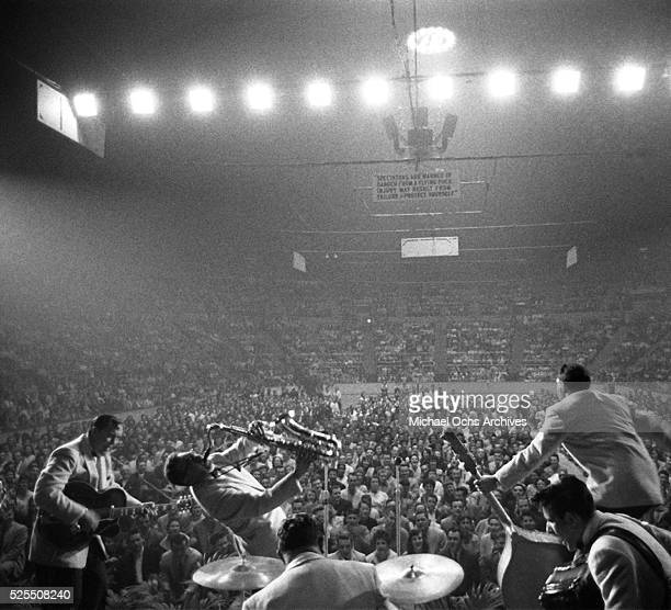 Bill Haley and his Comets LR Bill Haley Rudy Pompilli Ralph Jones Al Rex and Johnny Grande perform onstage at the Sports Arena on April 20 1956 in...