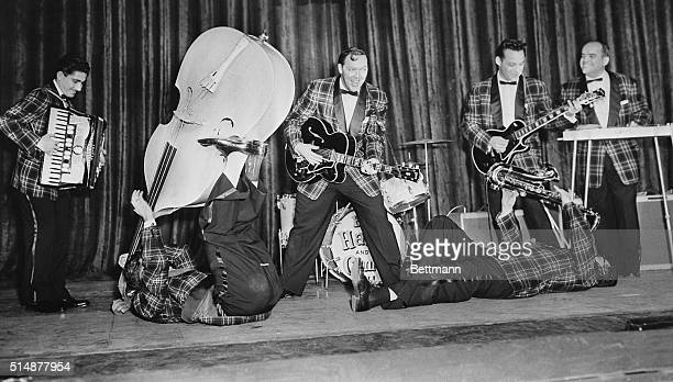 Bill Haley His Comets rehearse at the Dominion Theatre in London where they will open their British tour The Comets include accordion player Johnnie...