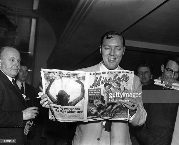 Bill Haley the American rock 'n' roll star pictured reading a copy of Mirabelle magazine during his British Tour Original Publication People Disc...