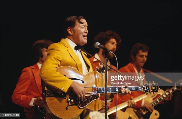 Bill Haley US rock and roll musician playing guitar and singing into a microphone during a live concert performance circa 1975 Haley's band The...