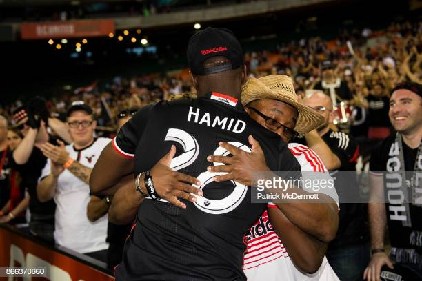 Bill Hamid of DC United hugs a fan after the New York Red Bulls defeated DC United 21 during the final MLS game at RFK Stadium on October 22 2017 in...