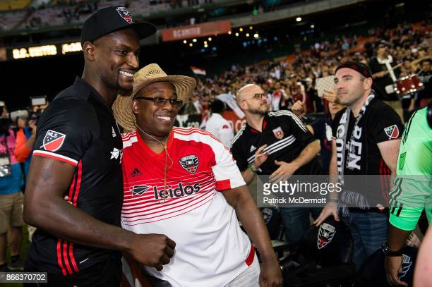 Bill Hamid of DC United takes a photograph with a fan after the New York Red Bulls defeated DC United 21 during the final MLS game at RFK Stadium on...