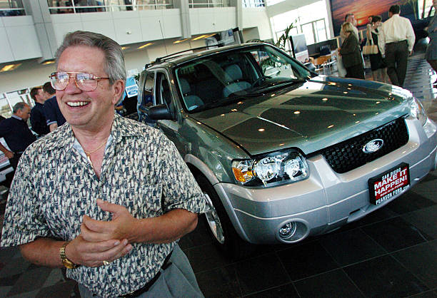 Bill Hammons Stands In Front Of His New 2005 Hybrid Ford Escape Suv Shown At Pearson