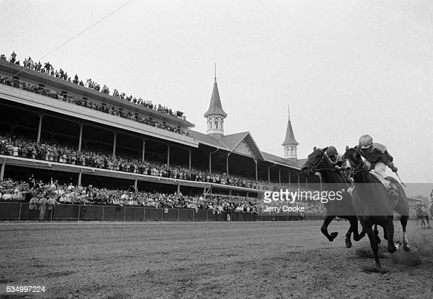 Bill Hartack rides Northern Dancer towards the finish line and wins the 1964 Kentucky Derby at Churchill Downs