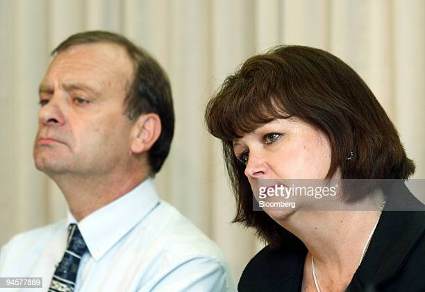 Bill Hawker left along with his wife Julia Hawker listens to questions during a news conference at the British Embassy in Tokyo Japan on Friday June...