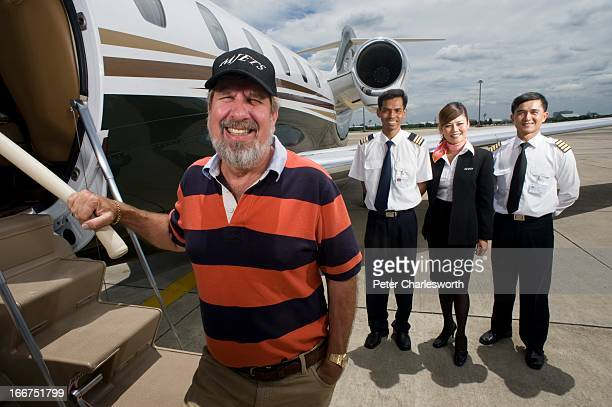 Bill Heinecke an American who has lived in Asia for most of his life and has taken Thai citizenship poses for a portrait in front of his company jet...
