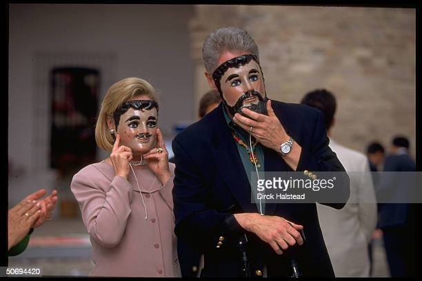Bill Hillary Rodham Clinton trying on conquistador masks in visit to market in Tlaxcala