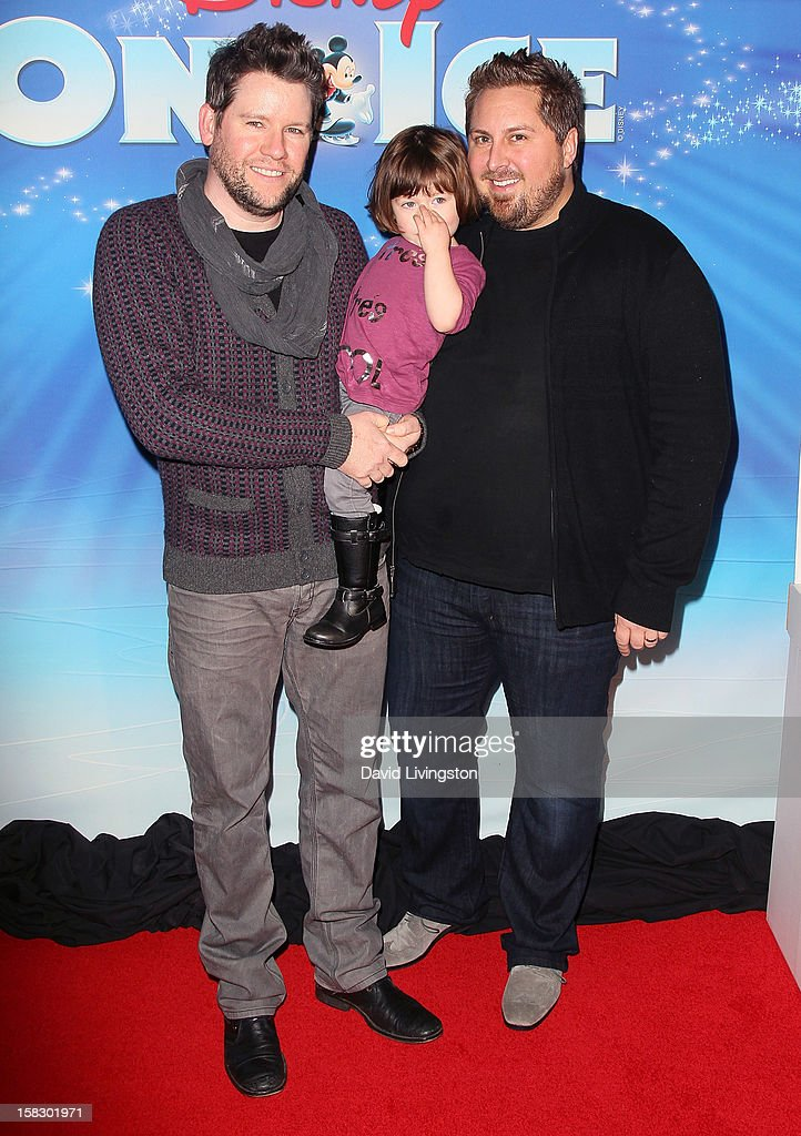 Bill Horn (L) and Scout Masterson (R) pose with their daughter Simone Masterson-Horn at the opening night of Disney On Ice's 'Dare To Dream' at LA Kings Holiday Ice at L.A. LIVE on December 12, 2012 in Los Angeles, California.