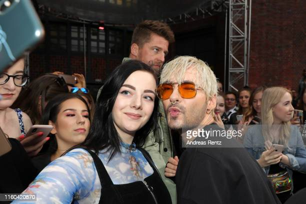 Bill Kaulitz takes a selfie with a fan as he attends the MDLA by Bill Kaulitz fashion show during the AYFW - About You Fashion Week at ewerk on July...