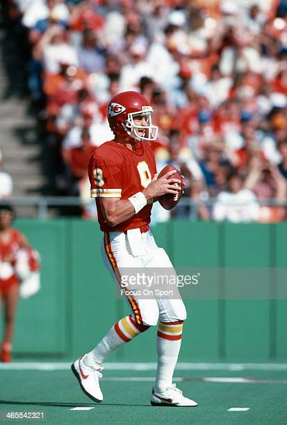 Bill Kenney of the Kansas City Chiefs drops back to pass against the Denver Broncos during an NFL football game October 27 1985 at Arrowhead Stadium...