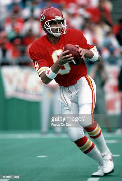 Bill Kenney of the Kansas City Chiefs drops back to pass during an NFL football game circa 1985 at Arrowhead Stadium in Kansas City Missouri Kenney...