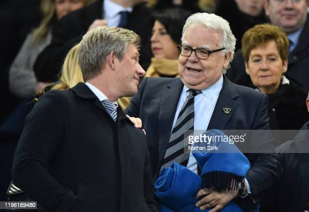 Bill Kenwright, Chairman of Everton talks to Marcel Brands, Director of Everton during the Premier League match between Everton FC and Burnley FC at...