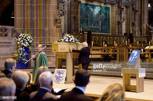 Bill Kenwright places his hands on the casket of Howard Kendall during the funeral of Howard Kendall at Liverpool Anglican Cathedral on October 29,...
