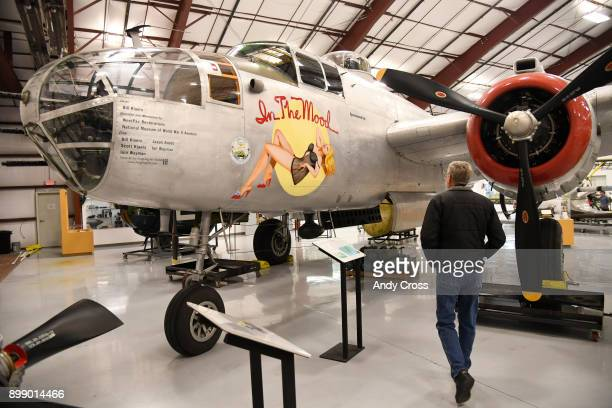 Bill Klaers president and CEO of the National Museum of WWII Aviation walks towards a North American B25 Mitchell bomber December 26 2017 Klaers was...