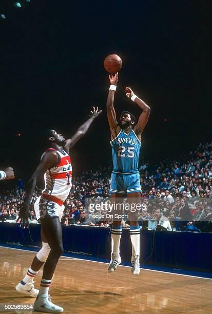 Bill Knight of the Buffalo Braves shoots over Bob Dandridge of the Washington Bullets during an NBA basketball game circa 1977 at the Capital Centre...