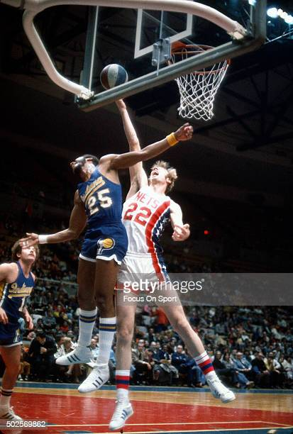 Bill Knight of the Indiana Pacers battles for a rebound with Ed Manning of the New York Nets during an ABA basketball game circa 1974 at the Nassau...
