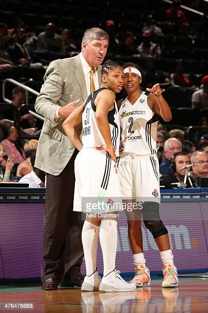 Bill Laimbeer head coach speaks to Tanisha Wright and Candice Wiggins of the New York Liberty during the game against the Indiana Fever in a WNBA...