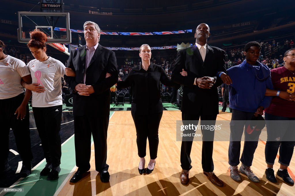 Bill Laimbeer, Katie Smith and Herb Williams of the New York Liberty stand for a moment of silence for the National Anthem before the game against the Minnesota Lynx during the WNBA game on August 20, 2017 at the Madison Square Garden in New York City, New York.