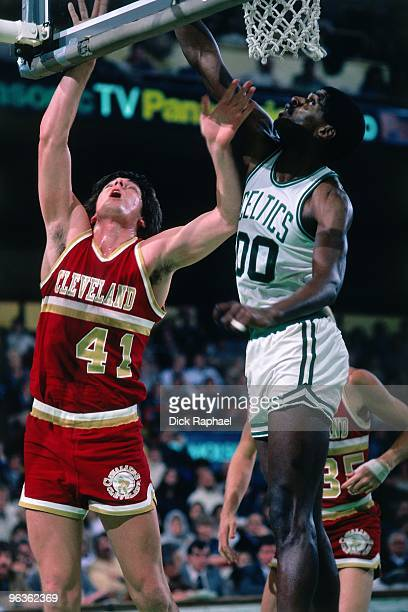Bill Laimbeer of the Cleveland Cavaliers shoots against Robert Parish of the Boston Celctis during a game played in 1981 at the Boston Garden in...