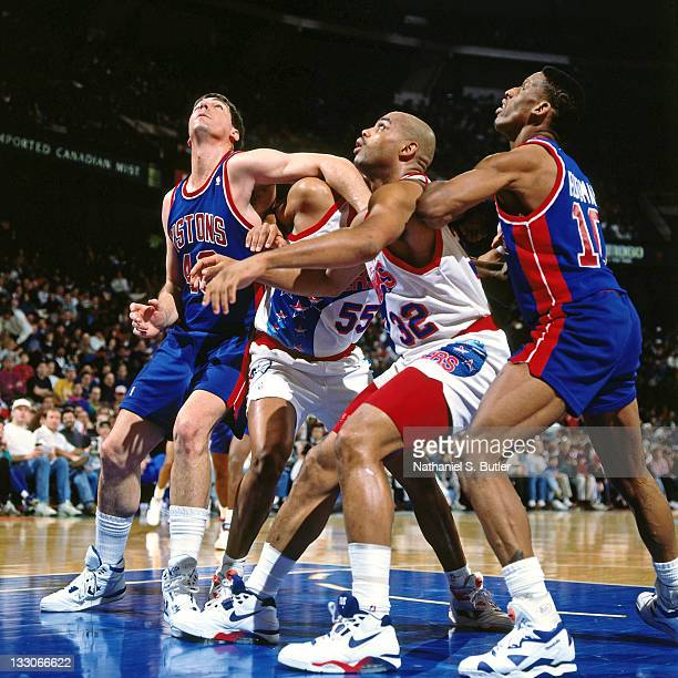 Bill Laimbeer of the Detroit Pistons boxes out against Charles Barkley of the Philadelphia 76ers circa 1991 at the Spectrum in Philadelphia...