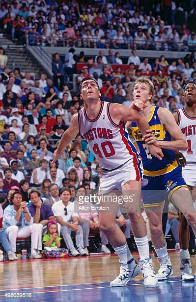 Bill Laimbeer of the Detroit Pistons boxes out against the Rik Smiths of the Indiana Pacers circa 1990 at the Palace of Auburn Hills in Auburn Hills...