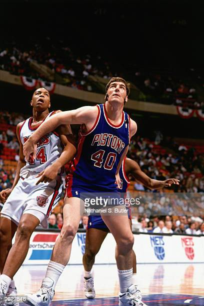 Bill Laimbeer of the Detroit Pistons boxes out in the paint against Derek Coleman of the New Jersey Nets at the Continental Airlines Arena circa 1990...