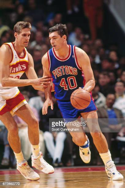 Bill Laimbeer of the Detroit Pistons dribbles against the Atlanta Hawks during a game played circa 1990 at the Omni in Atlanta Georgia NOTE TO USER...