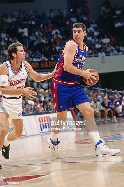 Bill Laimbeer of the Detroit Pistons drives against the Los Angeles Clippers circa 1993 at the LA Sports Arena in Los Angeles California NOTE TO USER...