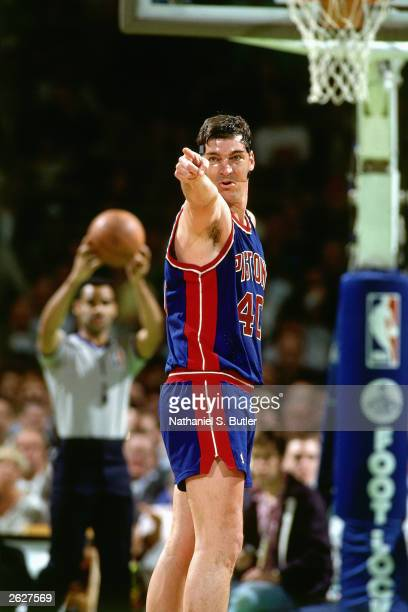 Bill Laimbeer of the Detroit Pistons points to a teammate after making a play during an NBA game circa 1990 NOTE TO USER User expressly acknowledges...