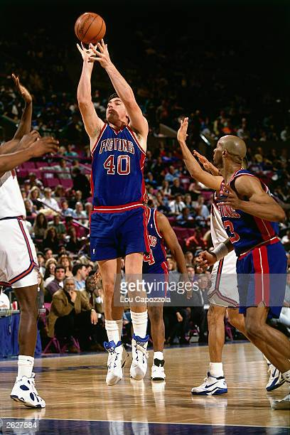 Bill Laimbeer of the Detroit Pistons shoots a jumpshot against the New Jersey Nets circa 1993 at the Continental Airlines Arena in East Rutherford...