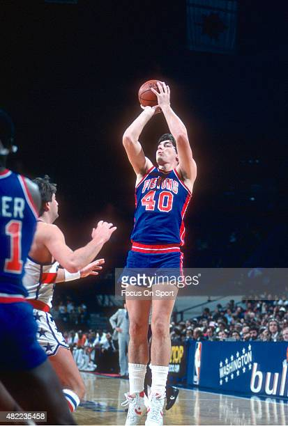 Bill Laimbeer of the Detroit Pistons shoots against the Washington Bullets during an NBA basketball game circa 1984 at the Capital Centre in Landover...