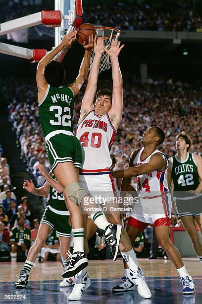 Bill Laimbeer of the Detroit Pistons takes a charge by a harddriving Kevin McHale of the Boston Celtics circa 1987 at the Palace in Auburn Hills...