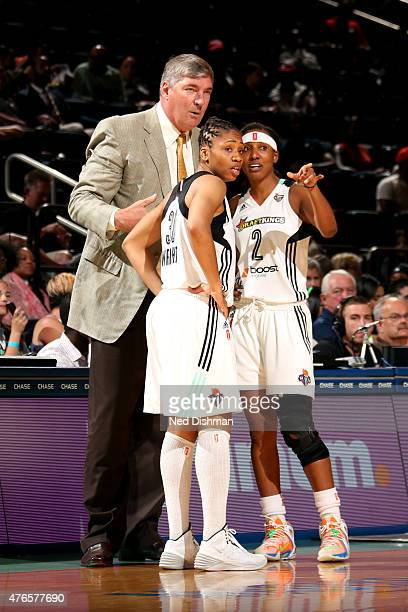 Bill Laimbeer Tanisha Wright and Candice Wiggins of the New York Liberty speak during a game against the Indiana Fever on June 9 2015 at Madison...