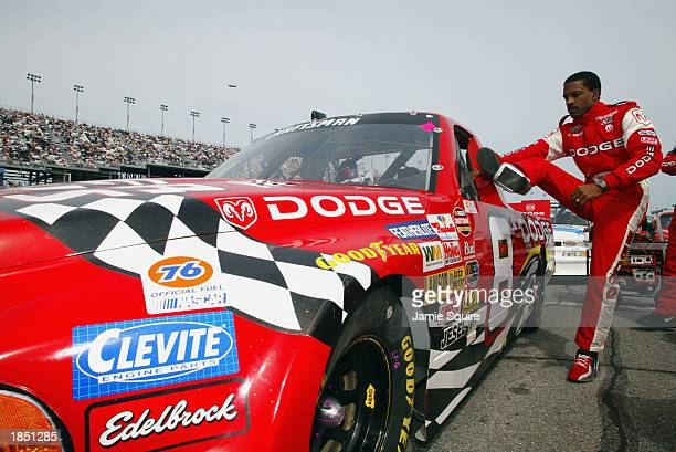 Bill Lester climbs into his Dodge Motorsports Dodge prior to the NASCAR Craftsman Truck Series Florida Dodge Dealers 250 at the Daytona International...